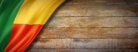 Benin flag on vintage wood wall banner