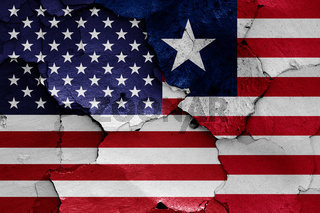 flags of USA and Liberia painted on cracked wall