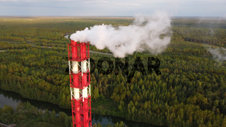 Air pollution by smoke coming out of factory chimneys. Bird's-eye view of the industrial zone in the Leningrad region