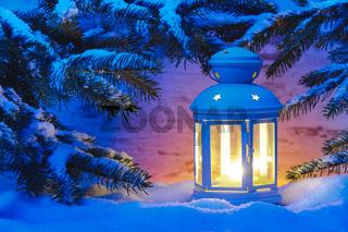 xmas candle light lantern in snow