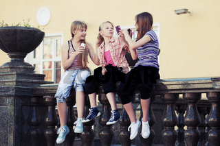 Teenage girls calling on the mobile phones
