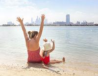 Happy family at the sunny beach