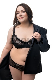 Coquettish overweight lady in lingerie and jacket