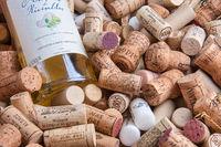 Still life wine bottle at background of wine bottle corks