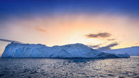 floating glaciers in sunrise at polar night