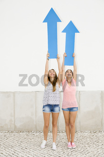 Teenagers pointing blue arrows