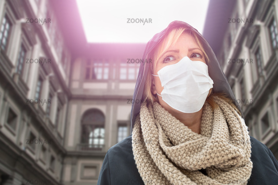 Young Woman Wearing Face Mask Walks Near the Uffizi Gallery In Italy