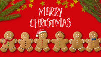 A christmas card with gingerbread men and christmas decoration