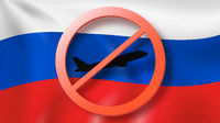 Forbbiden sign with crossed out plane on the background of Russian flag.