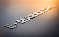 Word e-marketing written with white solid letters