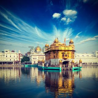 Vintage retro hipster style travel image of famous India attraction Sikh gurdwara Golden Temple (Harmandir Sahib). Amritsar