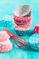 Variation of small paper forms for baking cupcakes and muffins with wisp. Colorful paper liners.