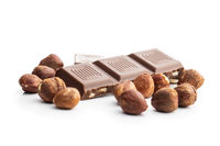 Milk chocolate bars and hazelnuts