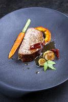 Minimalistic gourmet meatloaf slice with vegetable