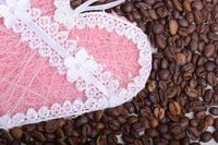 Coffee beans and love heart . Roasted aromatic brown coffee beans close up