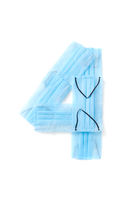 Number four made from protective medical masks on a white background.