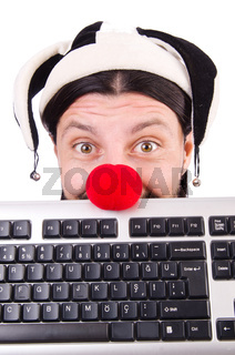 Funny clown with keyboard isolated on white