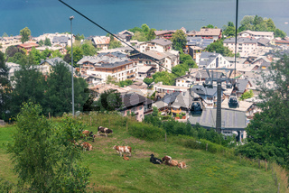 Panorama of the city of Zell am See with Zeller Lake in summer. Nature panoramic view of mountain, meadows and Tirol Alps in Salzburger Land, Austria.