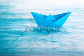 A Origami Paper Boat alone in the Sea