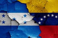 flags of Honduras and Venezuela painted on cracked wall