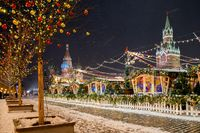 Moscow, Russia - February 04, 2020: Winter Moscow. Chimes in capital of Russia. Kremlin on Christmas night. Tree with garlands next to Kremlin