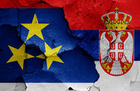 flags of Autonomous Province of Vojvodina and Serbia painted on cracked wall