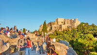 Crowd of people on The Areopagus rock in Athens