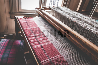 Traditional old vintage weaving loom as a professional handwork manufacturing tool for handmade weave production in a textile workshop