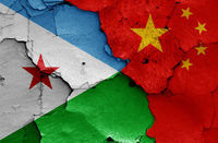 flags of Djibouti and China painted on cracked wall