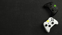 White and black joystick with black stone background top view 3D rendering