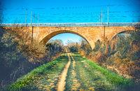 trail foot path urban colour jog under straight bridge urban