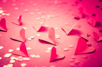 Red paper hearts on red background as background. Concept of love and Valentine