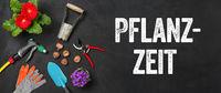 Garden tools on a dark background - Planting time - Pflanzzeit (German)