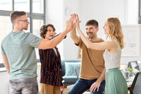happy business team making high five at office