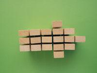 Arrow shape with wooden blocks on green