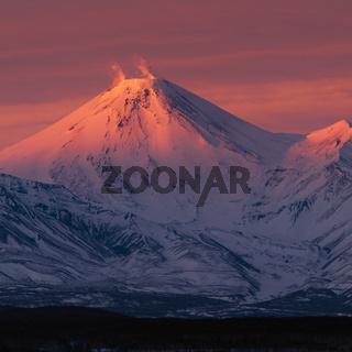 Winter volcanic landscape of Kamchatka Peninsula at violet sunset