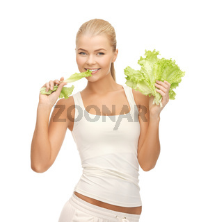 woman biting lettuce