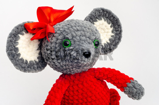 Portrait of a teddy mouse with a red bow on its head