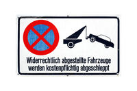 German sign isolated over white. Vehicles illegally parked will be towed away for a fee