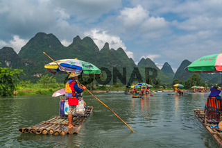 Wooden bamboo rafts on Yulong River in China