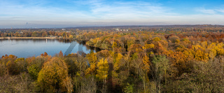 Colorful autumn trees in the Sechs-Seenplatte recreation area in Duisburg, North Rhine-Westphalia, Germany