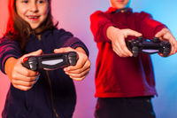 Happy friends holding joysticks and start virtual game