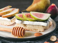 Toast with black camembert cheese and figs