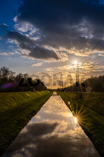 Reflections of sun rays in Emscher river, North Rhine-Westphalia