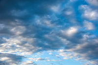 Natural sky composition. Sunny vast blue sky abstract background. Beautiful cloudscape, view over white fluffy clouds. Freedom concept, on the heaven. Element of design.