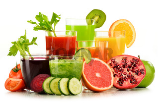 Glasses with fresh organic vegetable and fruit juices isolated on white. Detox diet.