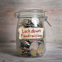 money jar with lockdown fundraising label.