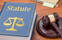 Law book with a gavel - Statute