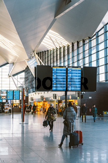Arrivals board at Gdansk, Poland, February 14, 2020 airport. Terminal of Gdansk airport (GDN) in Poland. Interior of modern terminal Lech Walesa Airport in Gdansk. Arrival departure board at terminal