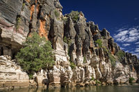 Western Australia – rocky eroded cliffs with trees and shrubs at a large river
